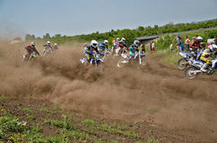 Start holeshot parts motocross group of riders Stock Photos