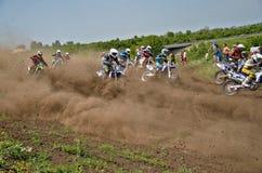 Start holeshot parts motocross group of riders Stock Photos