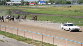 Start of horserace with jockeys in carts stock video footage