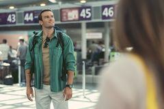 Attractive cute guy is waiting for flight Stock Photography