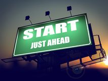 Start Just Ahead on Green Billboard. Royalty Free Stock Image