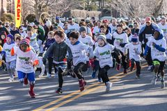 Start of Kids Fun Run. Garden City, NY, USA – 24 March 2018: Kids Fun Run start at the Run for Tomorrows Hope Foundation 5K, to support Catholic Education on Royalty Free Stock Photography