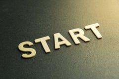 Start letter. Wooden letter of word  start on black background Stock Photography