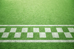Start line pattern on the green grass Stock Photo