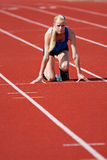 Start Line Position. A young, track and field athlete on the starting block Royalty Free Stock Photos