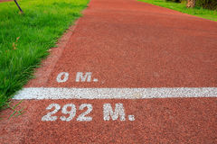 Start line of run track. Start and end line on a cycle red run track Royalty Free Stock Images