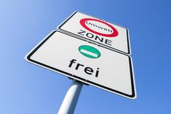 Start of a low-emission zone. German road sign: start of a low-emission zone, vehicles with green low-emission zone sticker permitted stock photos