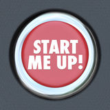 Start Me Up Car Starting Button Engine Excitement Arousal. The words Start Me Up on a round car start ignition button to illustrate getting excited, motivated Stock Photos