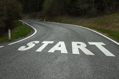 Start message on the asphalt countryside road Stock Photos
