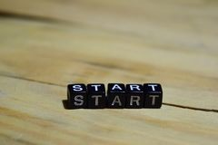 Start message written on wooden blocks. royalty free stock photography