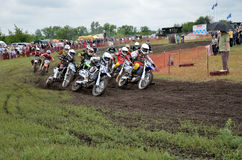 Start motocross riders Stock Photos