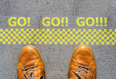Start a new career concept with man feet at start line Royalty Free Stock Images