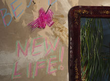 Start a new life. The wall in the apartment during the repair with the words `New Life stock image