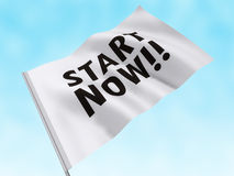 Start Now. Start flag with words on it Royalty Free Stock Photos
