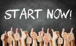 Start now. Many thumbs go up start now royalty free stock photo