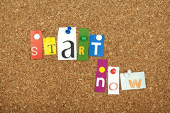 START NOW. Single letters pinned on cork noticeboard Stock Photography