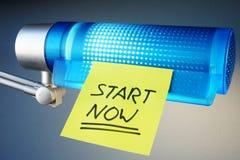 Start Now written on a memory stick. Start Now written on a memory stick on a lamp Royalty Free Stock Photography