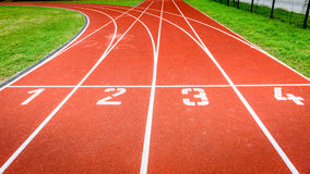 Start numbers on athletic running track in stadium. Royalty Free Stock Photography