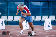Start old men from starting blocks. Chelyabinsk, Russia - August 28, 2015:  start old men from starting blocks during championship of Russia on track and field Stock Images
