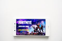 Ufa, Russia - March 15, 2019: Fortnite game on Android smartphone screen, phone on white background, copy space. Start page of Fortnite game on Android royalty free stock image