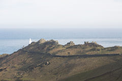 Start Point. Start Point juts out into the sea and is a good location for a light house. A rocky spine follows the hilltop down the the lighthouse making an stock photo