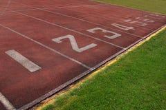 Start point, track in stadium. Start point, number on  track in stadium Stock Photo