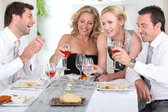 Start of a posh dinner. Four joyful people at the start of a posh dinner Royalty Free Stock Photography