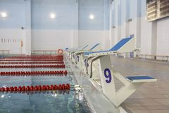 Start position with number 9 in competition swimming pool royalty free stock image