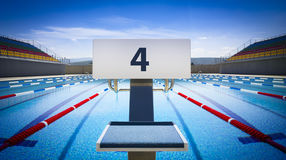 Start positions number 4 in competition swimming pool Royalty Free Stock Photo