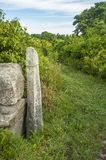 Stone marker at beginning of Quansett Trail royalty free stock photos