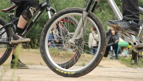 Start of race BMX bicycle circuit competition, two men ride. Stock footage stock video footage