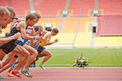 Start of race at Grand Sports Arena. MOSCOW - JUN 11: Start of race at Grand Sports Arena of Luzhniki Olympic Complex during International athletics competitions stock image