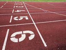 Start. Red running racetrack on the outdoor athletic stadium Royalty Free Stock Image