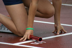 The start of the relay. Female athlete Stock Images