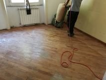 Start sanding parquet. Damaged cherry parquet as it begins to be polished Royalty Free Stock Photo