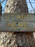 Start sign nailed to a tree Stock Photos