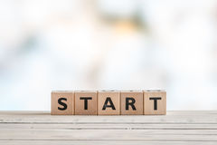 Start sign on a wooden table Royalty Free Stock Photos