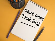 Start Small Think Big, Motivational Words Quotes Concept. Start Small Think Big, business motivational inspirational quotes, words typography lettering concept royalty free stock images