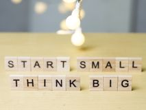 Start Small Think Big, Motivational Words Quotes Concept. Start Small Think Big, business motivational inspirational quotes, words typography lettering concept royalty free stock image