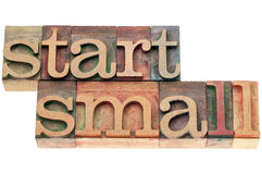 Start small in wood type Royalty Free Stock Image