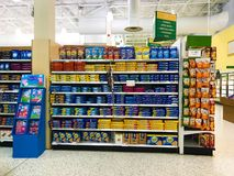 Start of the Snack Aisle of a Grocery Store. Gold Fish and many different types of Oreos for sale in the snack and cookie aisle of a grocery store royalty free stock image