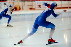 start sprint race of two women athletes speed skaters royalty free stock image