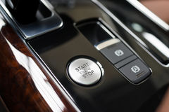 Start stop engine button. Luxury sport car interior Royalty Free Stock Images
