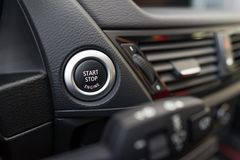 Start stop engine button. Luxury sport car interior Royalty Free Stock Photography