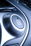 START and STOP ignition button in car, vehicle. Start or stop ignition button in car, vehicle with visible fragment of instrument panel in vehicle interior Royalty Free Stock Images