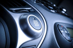 START and STOP ignition button in car, vehicle. Start or stop ignition button in car, vehicle with visible fragment of instrument panel in vehicle interior Stock Photos