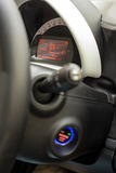 Start stop key into the lock of ignition of the car. Stock Images