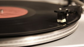 Start and stop playing record. Start and stop playing a vinyl record stock footage