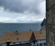 Start of a storm over lake Geneva in Swtzerland, view on Musee Suisse du jeux royalty free stock image