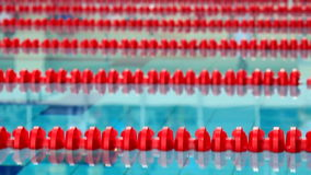 Start of swimming competion, jump to the water stock footage